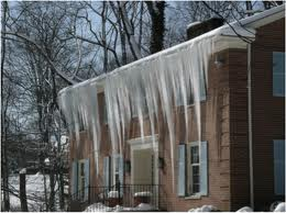 Image of: home with large chunks of ice hanging from roof.